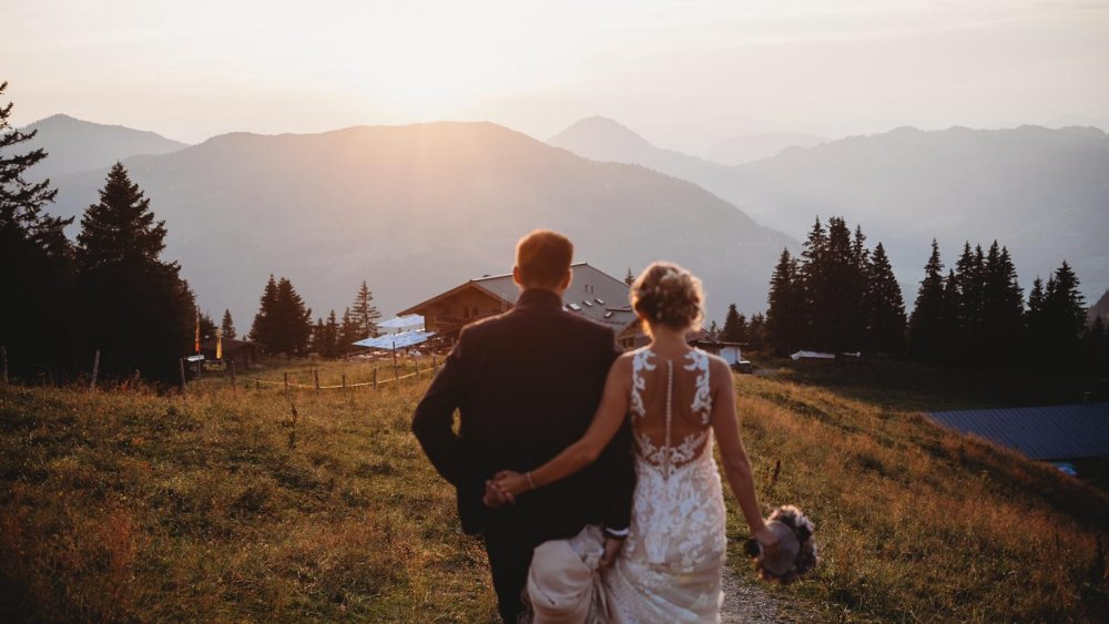 mountain wedding kitzbuehel austria couple from behind