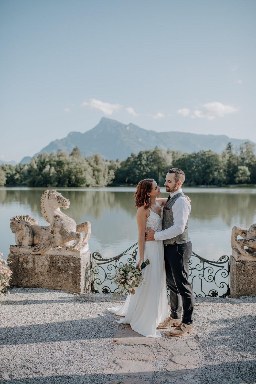 fairy-tale wedding salzburg schloss leopoldskron couple view Untersberg