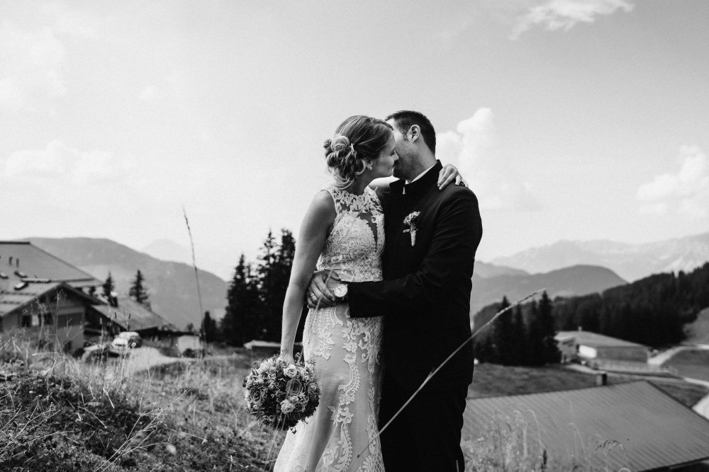 mountain wedding kitzbuehel austria kissing couple bw