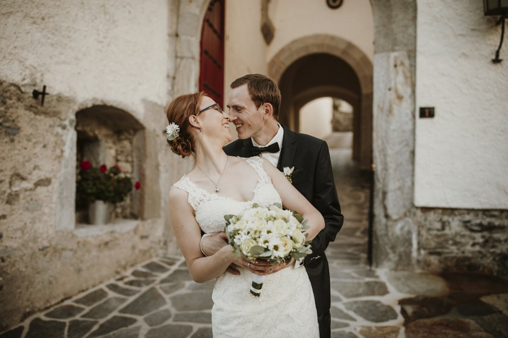 Castle wedding Austria Alps Schloss Mittersill couple laughing