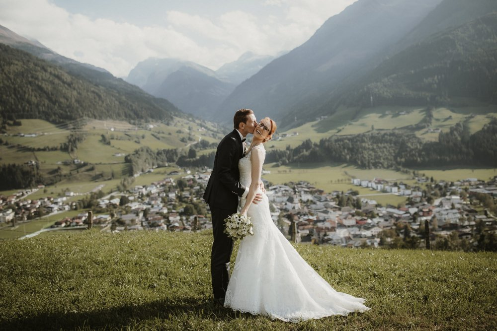 Castle wedding Austria Alps Schloss Mittersill couple with view
