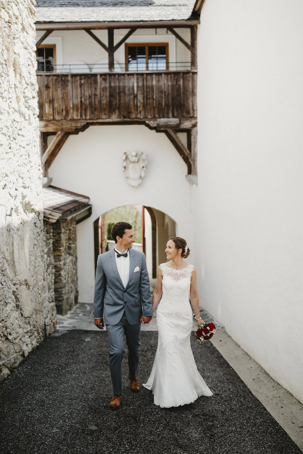 Castle wedding Austria Alps Schloss Mittersill couple walking