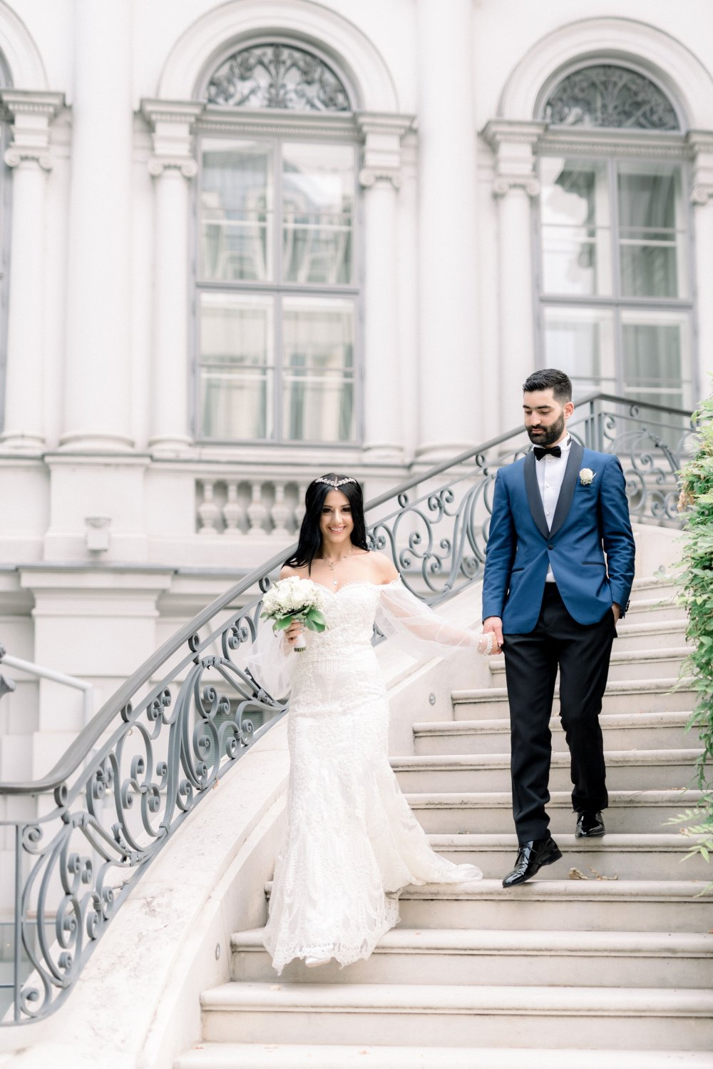 luxury wedding vienna austria palais coburg couple on stairs outside